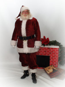 Santa Howard standing in front of fireplace - Have Santas Will Travel