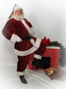 Naturally bearded Santa Howard in front of fireplace - Have Santas Will Travel