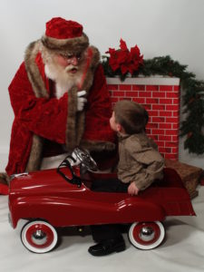 Naturally bearded Santa Howard with child - Have Santas Will Travel